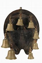 ENGLISH DINNER BELL SET - Eight-Bell Octave Set of Brass Bells suspended from hobnail form brackets mounted on oak horsehoe form plaque