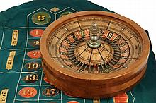 ROULETTE WHEEL & TABLE COVER - Circa 1910s Wooden Roulette Wheel, handpainted, with nickel plated post; PLUS handpainted table cover si