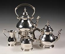 SILVER TEA SERVICE - (4) Pc English Sterling Silver Tea Service, hallmarked for London 1952 by silversmith Edward Barnard & Sons Ltd. 9