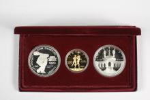 COINS - (3) Pc 1983 Olympic Proof Set with Gold. With papers and box.