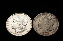 COINS - (2) 1878-CC Morgan Dollars. One VF, One Good.