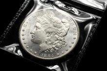 COIN - (1) 1884-CC Morgan Dollar. CH BU.