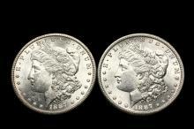 COINS - (2) 1887-S Morgan Dollars, BU. Both decent.