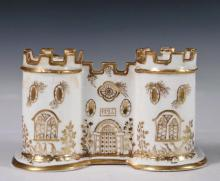 MINTON PORCELAIN INKWELL - Double Inkwell in the form of a Twin Turreted Castle, dated 1724 (the company was established in 1793), listed as shape no. 43 in the Minton Factory Books. Gilt decoration of white porcelain...
