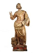 ITALIAN ECCLESIASTICAL CARVING - Large Carved Wood and Polychrome Figure of an Apostle, 17th c. Saint Mark the Evangelist, depicted with eyes raised, right hand gesturing, bible in left hand, lion at his feet, on inte...