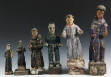 (6) SPANISH COLONIAL SANTOS - 19th c. Figures of Male Saints, (four of John the Baptist, holding the Christ child), with tags indicating sources of Columbia and Peru. Ranging in size from 8