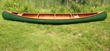 OLD TOWN CANOE - 18' Canoe Guide model made by the Old Town Canoe Company and built in June of 1956, S/N 165232. Canvas covered cedar ribs and planking, mahogany trim. 36