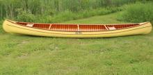 OLD TOWN CANOE - 20' Canoe Guide model made by the Old Town Canoe Company in April of 1981, S/N 237938. Canvas covered cedar ribs and planking, mahogany trim. 38
