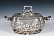 COVERED VEGETABLE SERVER - Tiffany & Co. Sterling Silver Covered Two-handled Vegetable Dish, c. 1880s, with ornate floral and foliate repousse decoration, heron heads at handle edges, four folded feet, #6007-4653, als...