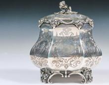 TEA CADDY - English Victorian Period Sterling Silver Footed Tea Caddy, London 1858 hallmarks, by Edward Ker Reid, with ribbed baluster shape, hinged lid and floral finial, gilt washed interior, intricate chased and en...