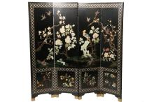 CHINESE FOLDING SCREEN - Four Panel Folding Screen in Black Lacquer with Carved Soapstone, Mother of Pearl and bas relief gold decoration, circa 1920s, depicting exotic birds among flowering shrubs, with a scholar's s..