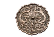 CHINESE HAND MIRROR - Tang Dynasty Bronze Mirror with shaped edge and loop for silk cord handle, decorated with relief of two dragons in confrontation among flames, censer at center, bird in water below, 5 1/8