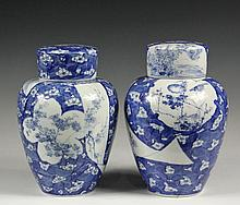 PAIR OF CHINESE COVERED GINGER JARS - Chinese Blue and White Cracked Ice Porcelain Ginger Jars, Kangxi (1662-1722) decorated with a hand fan, silk scroll and cloud-shaped panels containing prunus, each complete with b...