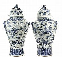 PAIR OF CHINESE PORCELAIN FLOOR STANDING COVERED TEMPLE URNS - Substantial High Shouldered Baluster Form Jardineres with domed covers in blue and white decoration, raised lion head bosses with faux ring bails, eight F...