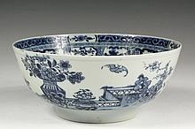 CHINESE EXPORT BOWL - Late 18th c. Canton Blue & White Bowl for the English Market, featuring vases of flowers on a veranda with bats in flight, the interior with a geometric band having floral swags beneath, cartouch...