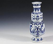 RARE FORM CHINESE PORCELAIN VASE - Eight-Sided, Two-Tiered Kangxhi Vase with typical blue and white decoration, slightly deformed, 10 3/4