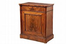CONSOLE CABINET- Figured Mahogany Cabinet, circa 1820, with quartered veneer turreted corner top, column form stiles, single drawer with lock (no key), single paneled door having crotch split veneer, with lock (and op...