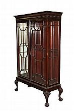 IRISH VITRINE CABINET - 19th c. Mahogany Cabinet with glass sides and double door front, Greek key and Gothic arch cornice, molded geometric mullions, two intermediate fixed shelves, lock with key, delicate acanthus c...