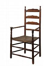 18TH C LADDERBACK ARMCHAIR - American Colonial Spindle Turned Armchair with turned finials, shaped back slats, mushroom capped ring and sausage turned front legs, early woven splint seat, double stretchers. 17