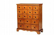 APOTHECARY CABINET - American 19th c. Tiger Maple Veneer 18-Drawer Apothecary Cabinet, in simple country form, having overhanging plank top, three rows of four drawers over two ranks of three, flush with frame, featur...