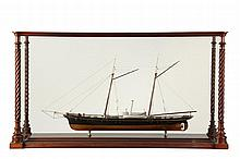 CASED SHIP MODEL - Unidentified Yacht, black-hulled, sail/steam, circa 1900. In ornate mahogany and glass case with twisted columns. 25