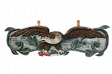 SHIP'S STERNBOARD - 20th c. Carved and Painted Pine Decorative Sternboard depicting an American Eagle grasping a red, white and blue riband, surrounded by ivy scrollwork, marked on back