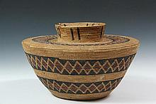 NATIVE AMERICAN BASKET - Yokut People, California, circa 1900, Shouldered Basket in devil's claw and firebrush, in 'Tulare Bottleneck' or 'Friendship' form, with red and black diamond banding. 7 1/2