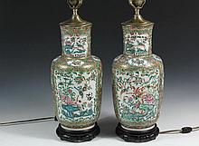 PAIR OF CHINESE PORCELAIN VASES AS LAMPS - 19th c. Famille Rose Baluster Vases decorated with multiple polychrome panels of landscapes with birds and insects, on a rose base with gilt fields, converted to electric lam...
