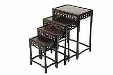 CHINESE NESTING TABLES - Set of Four Tables, late 19th to early 20th c., in rosewood, having paneled tops, openwork carved friezes, each raised on four carved legs connected by stretchers, the largest is 28