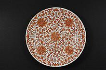 CHINESE EXPORT PORCELAIN CHARGER - Iron-Red and Gilt Plate, Qing Dynasty, decorated with bats and shou characters (for long life) amidst leafy lotus with five blossoms on a cross, bamboo on the under rim, chip to unde...