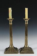 PAIR 18TH C BRASS CANDLESTICKS - English George III Column Form Candlesticks, second half 18th c., retaining the original beaded edge square bobeches, ring turned stop fluted shaft, square multi-stepped and gadrooned ...