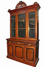 VICTORIAN TWO-PART STEPBACK CUPBOARD - English Aesthetic Period Large Red Walnut Cupboard with ebonized detailing, deep molded cornice having central arched crest flanked by two smaller split rosettes, the upper cabin...
