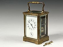 MINIATURE CARRIAGE CLOCK - Brass Cased Hour Repeater Clock, with beveled glass, enameled face with alarm, marked