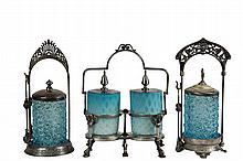 (2) VICTORIAN SILVER PLATE & GLASS PICKLE CASTORS & (1) DOUBLE - The Two Singles with cut snowflake ice blue glass jars, with engraved lids and tongs, one is marked Boston Plate Co., 11