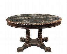 MARBLE TOP CENTER TABLE - American Renaissance Revival Oval Walnut Table with black and tan marble set into a carved wooden frame, supported by four inset sturdy twist columns, on a central shaped platform raised on t...