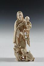 19TH C JAPANESE CARVING - Meiji Period Cabinet Figure or Okimono, of a mother carrying her child, holding a peony branch in her other hand, her child taunts a monkey with a peach branch on a cord. Unsigned. 6