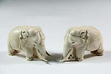 PAIR OF CHINESE FIGURES - 19th c. Standing Elephants with trunks curled on the ground, inset black bead eyes, unsigned, 4 1/4