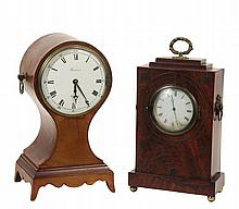 (2) ENGLISH MANTLE CLOCKS - Both 19th c, wooden cased, including: Regency Style Balloon Form on shaped bracket base, in mahogany and butternut, with banded edge, brass drop ring handles, having an enameled dial marked...