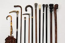 COLLECTION OF (12) CANES, WALKING STICKS, & ETC - All 19th c., including: Green Alligator and Engraved Gold Band Cane, 34