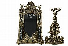 BRASS DRESSING MIRROR & DOOR PORTER - Ornate Heavy Cast Brass Dressing Mirror, late 19th to early 20th c., with floral draped top flanked by open handled urns, the rectangular looking glass having cut drapery swag and...