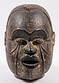 AFRICAN HEAD - Delta Igbo People, Bendel, Nigeria, full head of Omu Guardian, in carved wood, with encrustation, square aperture in bac