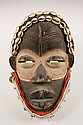 AFRICAN MASK - Dan Mask, Ivory Coast, with sanded paint, glass beads, seashells, single metal bell remaining attached to canvas collar