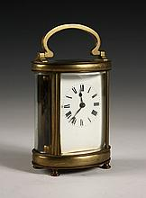 BRASS CARRIAGE CLOCK - Oval Gilt Brass and Beveled Glass Carriage Clock, unmarked, early 20th c. Probably a French movement. 5 1/8