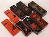COLLECTION (8) JAPANESE LACQUER BOXES - Glove Boxes in Black or Cinnabar, decorated with gilt birds, blossoms or landscapes. 12