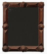 TRAMP ART FRAMED MIRROR - Circa 1910 Mahogany Frame with stacked pyramid and cone design, natural finish, made from old cigar boxes. 34