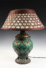 CHINESE TABLE LAMP - Rattan Wrapped Green Pottery based kerosene lamp converted to electric, with the original rattan cloth-lined shade