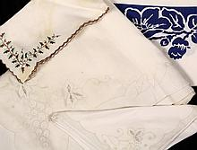 BOX OF TABLE LINENS - Early 20th c. Table Linens including damask, cut-work and printed textiles. Some matching napkin sets.