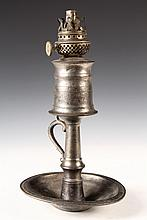 EARLY PEWTER SHIPBOARD WHALE OIL LAMP - Cast Pewter Lamp with loop handle, turned and tapered column, deep pan base meant to fit into r
