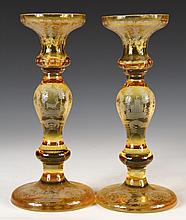 PAIR OF BOHEMIAN CANDLESTICKS - Amber Cut to Clear Baluster Candlesticks with wide bobeches, wheelcut scenes of castles and game, garde