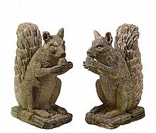 PAIR OF CAST STONE SQUIRRELS - Early 20th c, depicted rising up on haunches, holding nut to mouth, tail curled behind. 22